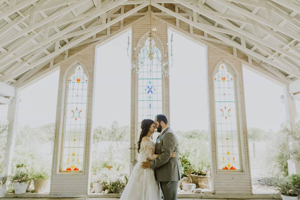 A Bride and groom in a chapel in New Braunfels