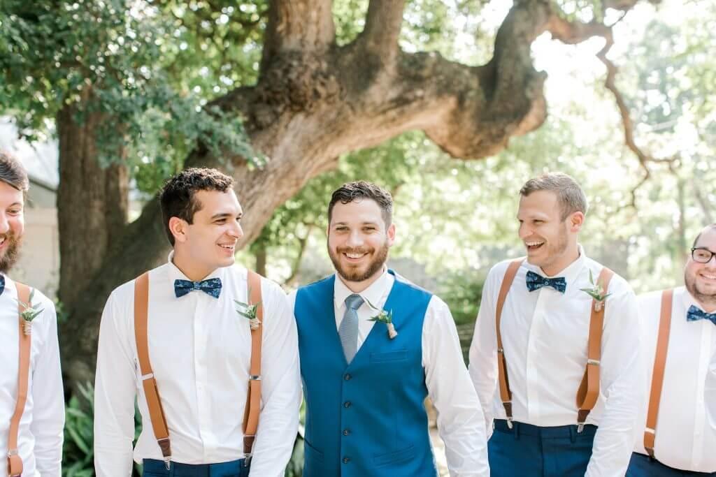 Groom and groomsman at Gruene Estate in Gruene Texas