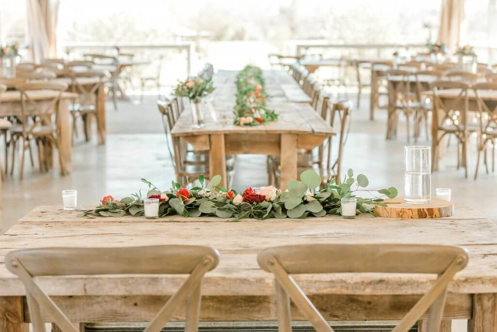 Gruene Texas Wedding Venue with rustic tables and floral centerpiece